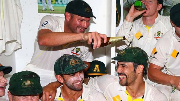Ryan Harris pours beer on Mitchell Johnson as the Australian team celebrates in the change rooms after day five of the ...