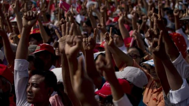 Voting for change: Supporters of Myanmar's opposition National League for Democracy  in a show of hands to amend the ...