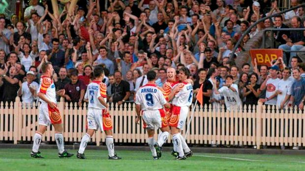 Northern exposure: Robbie Slater celebrates a goal in front of a healthy North Sydney Oval crowd in 1999.