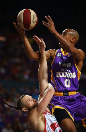Kings combo guard Charles Carmouche drives to the basket against Hawks centre Larry Davidson during Sydney's loss to ...