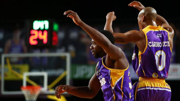 Kings imports Sam Young and Charles Carmouche celebrate after the forward's dunk against the Hawks but Sydney ended up ...
