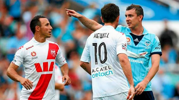 Mouthing off: The once quiet Seb Ryall of Sydney FC gives Harry Kewell a mouthful after the Heart star badly missed a ...