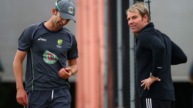 Shane Warne and Nathan Lyon during a nets session at Old Trafford in July.