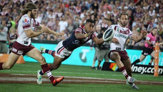 Match-winner: Roosters centre Michael Jennings shows no thought for self-preservation with his spectacular try in the ...