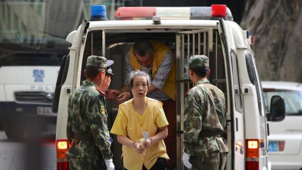 Charlotte Chou is escorted to court.