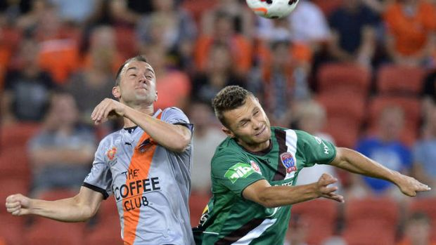 Ivan Franjic of the Roar and Samuel Gallaway of the Jets compete for the ball.