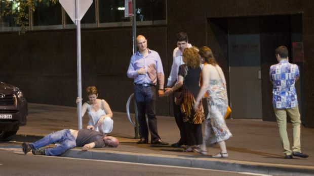 A man lies passed out on a Sydney street.
