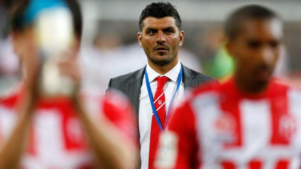 John Aloisi cut a lonely figure after the final whistle.