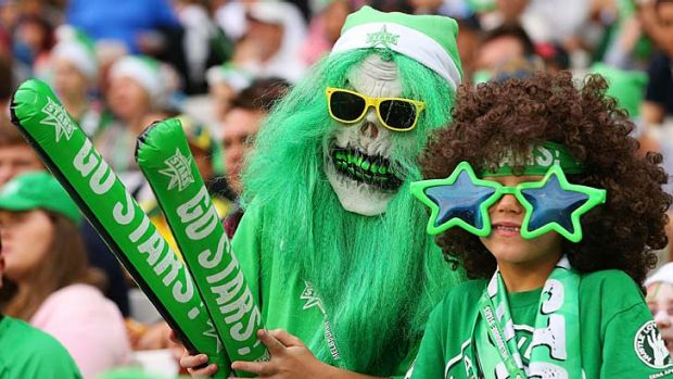 TV spectacle: Melbourne Stars' fans show their support during the Big Bash opener against the Melbourne Renegades.