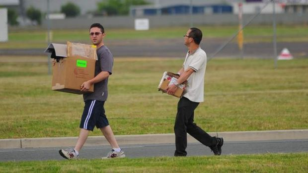 Packing up ... Staff leave Brindabella Airlines after the announcement.