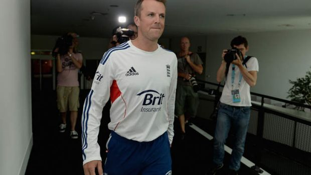 Graeme Swann of England arrives at a press conference to announce his retirement.