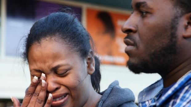 Fighting to keep ventilator on... Nailah Winkfield, mother of 13-year-old Jahi McMath, wipes her face while speaking to ...
