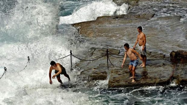Swimmers take a rough dip at The Bogey Hole in Newcastle.