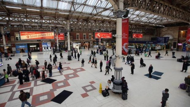 Passengers wait for trains in Victoria Station as severe weather has caused delays and cancellations to numerous UK rail ...