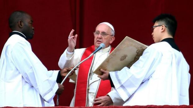 Pope Francis delivers his Christmas Day message from the central balcony of St Peter's Basilica.