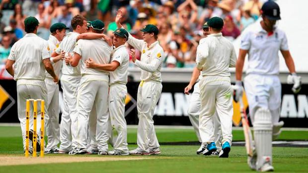 One down: Peter Siddle and the Australians celebrate after taking the wicket of Alastair Cook.