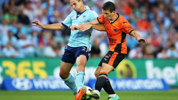 Liam Miller of the Roar goes head to head with with Richard Garcia of Sydney FC.