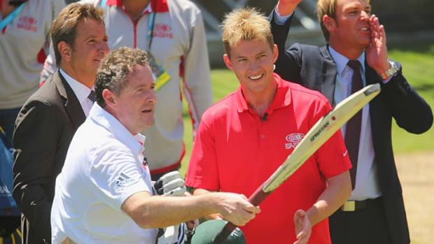 Piers Morgan salutes the crowd after 'surviving' an over from Brett Lee.