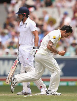 Mitchell Johnson celebrates after taking the wicket of  Alastair Cook.