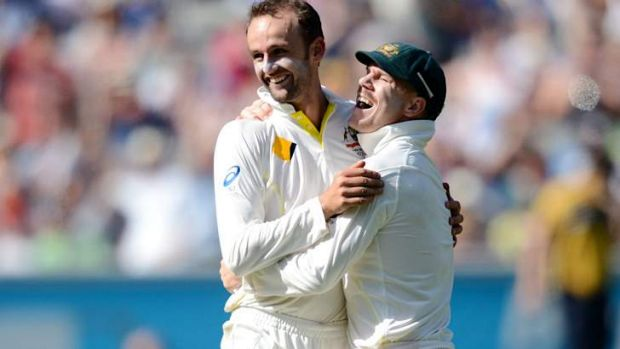 Come in spinner: Nathan Lyon and Dave Warner celebrate another wicket.
