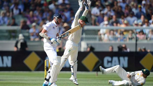 Take that: England's Stuart Broad is caught by Australian captain Michael Clarke as wicketkeeper Brad Haddin celebrates.