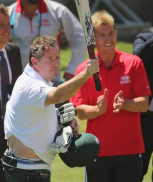 Piers Morgan salutes the crowd after facing deliveries from Brett Lee in the nets.