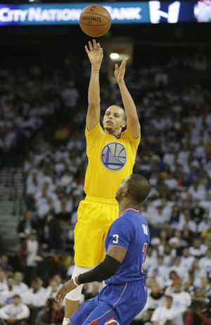 Golden State Warriors guard Stephen Curry takes a shot over Los Angeles Clippers counterpart Chris Paul.