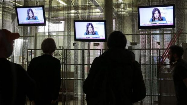 National attention: People watch a live news conference with Pussy Riot after their release from prison.
