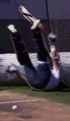 Danger zone: Piers Morgan falls to the ground during a batting contest with Brett Lee.