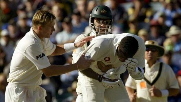 Brett Lee and Justin Langer come to the aid of English batsman Alex Tudor after he was struck near the eye during the ...