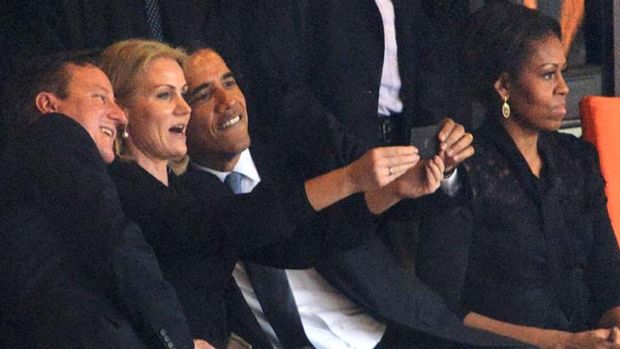 Getting in on the act: Barack Obama's selfie at Nelson Mandela's memorial service in Johannesburg.