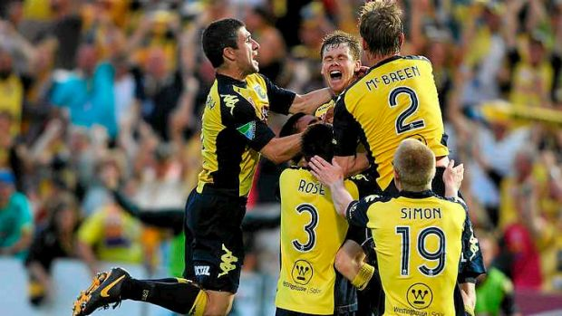 Cliffhanger: Mariners players celebrate Mike McGlinchey's 95th minute winner against Perth Glory.
