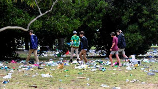 Partygoers wade through the mess at Edinburgh Gardens.