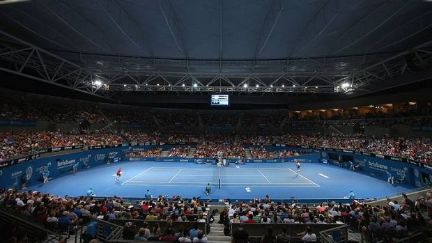 Roger Federer and Jarkko Nieminen play in front of a packed Pat Rafter Arena crowd.
