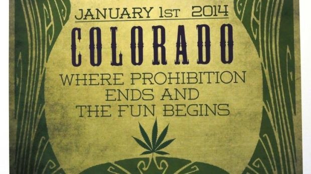 A sign celebrates opening day at the Botana Care marijuana store in Northglenn, Colorado.