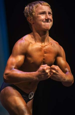 Flexing his muscles: Jake Schellenschlager at the 2013 Musclemania Capitol Tournament of Champions in May.