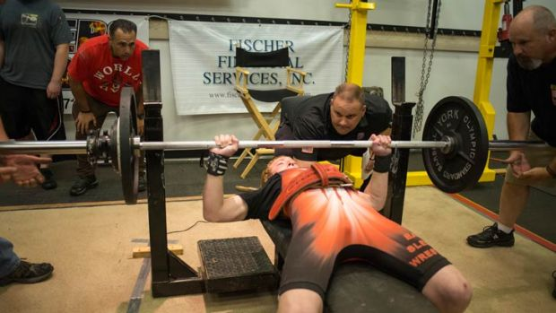 Jake Schellenschlager, 13 at the time, sets a bench-press record for his age and weight at the 2013 IPA Strength ...