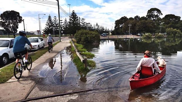 King Tide: The tide causes mild flooding Holbeach Avenue in Tempe.