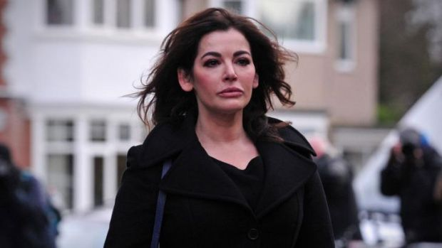 Defending her brand ... British television chef Nigella Lawson arrives at Isleworth Crown Court in west London, on ...