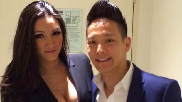 Eric Woo, pictured with an unnamed woman.
