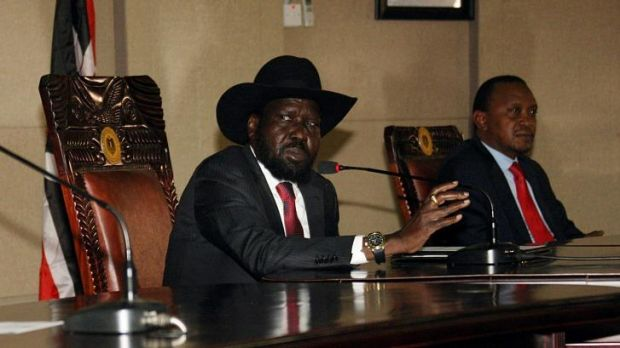South Sudan President, Salva Kiir, left,  with his Kenyan counterpart Uhuru Kenyatta during peace talks on Boxing Day at ...