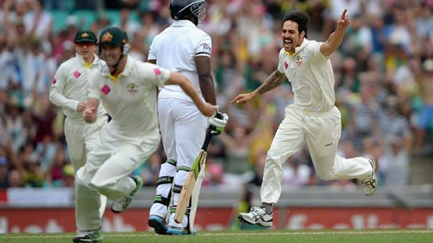 Early wicket ....  Mitchell Johnson after removing Michael Carberry.