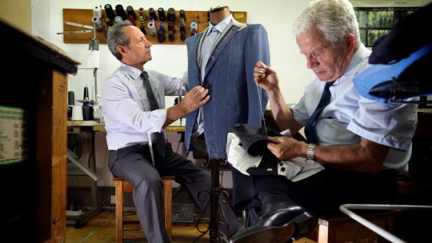 Master tailor Tino Di Mattia (left) and Pasquale Strangis perform their craft at American Tailors in Bourke Street.