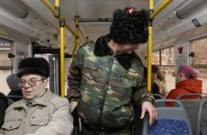 Alert: A Cossack patrols a bus in central Volgograd. Authorities are said to suspect ethnic Russian converts to Islam ...