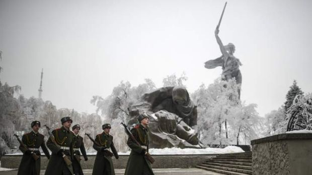 On their guard: Security personnel on patrol near the Motherland Calls statue in Volgograd.