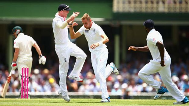 Stuart Broad celebrates after taking the wicket of George Bailey.
