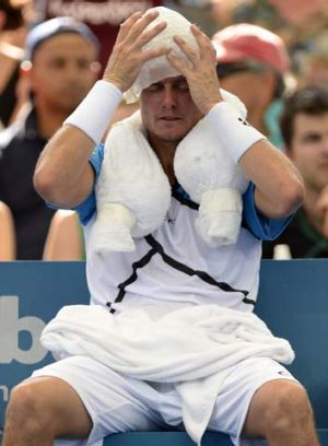 Career not on ice ... Lleyton Hewitt attempts to cool down in Brisbane.