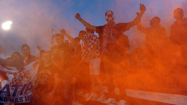Canberra FC fans let off flares early in the game against Olympic in 2011. Heather Reid says capital Football will adopt ...