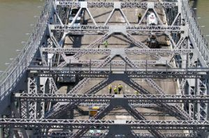 Brisbane City Council workers brave hot temperatures on the weekend to resurface the road on the Story Bridge. The ...