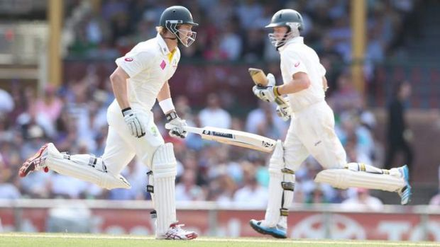 Nice day for a run: Shane Watson and Chris Rogers run between the wickets on Saturday.